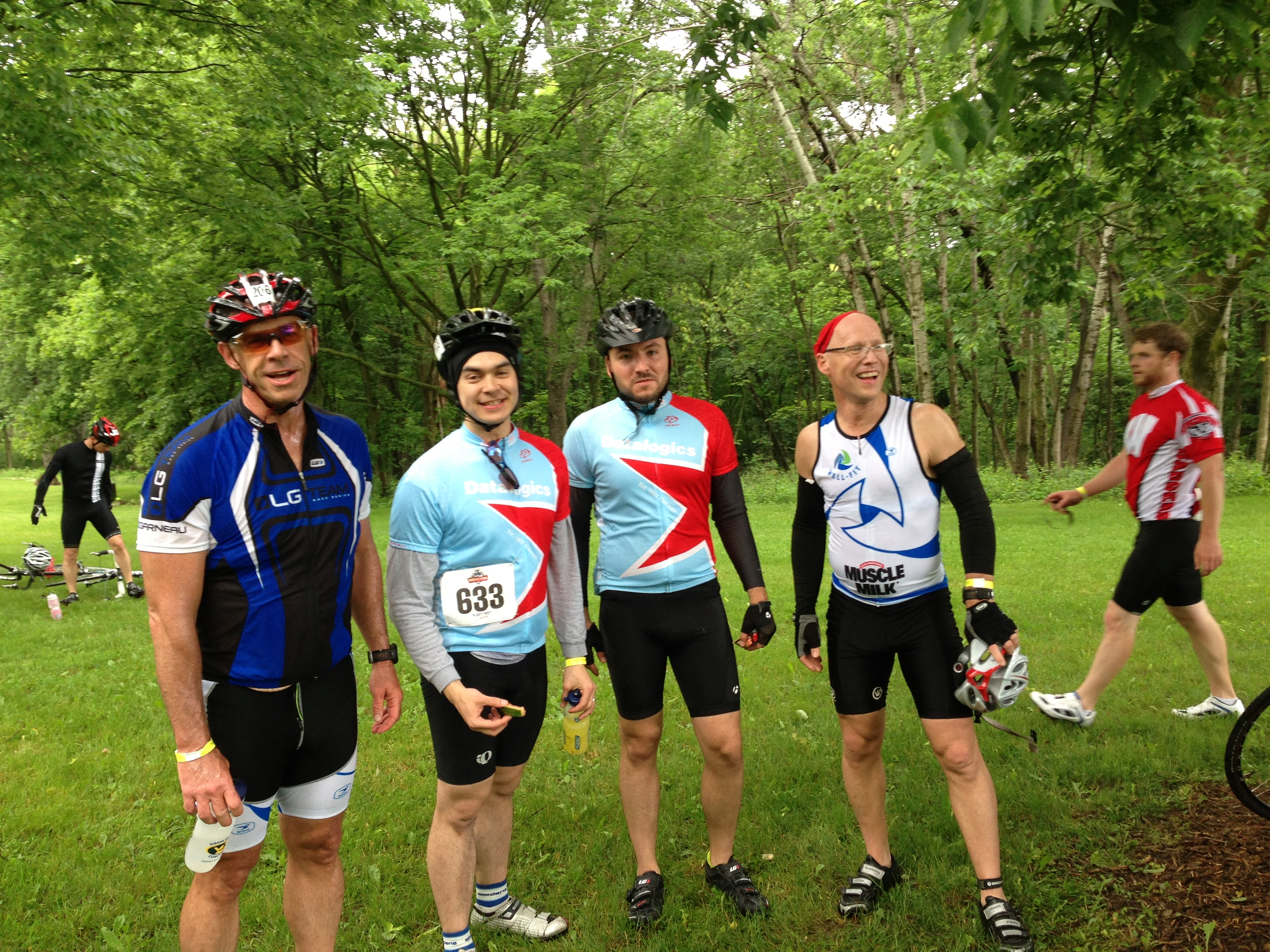 DL Cycling Club members Alex and Jeff flanked by other riders
