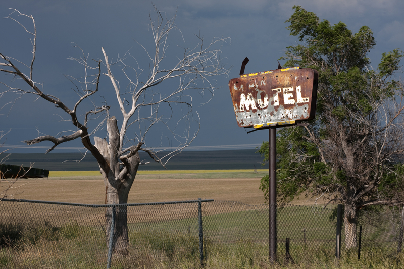 http://www.dreamstime.com/royalty-free-stock-photography-rusty-old-motel-sign-tree-image28601127